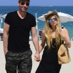 Exclusive... 51736773 Singer Avril Lavigne enjoys a romantic stroll on the beach with her husband Chad Kroeger on May 11, 2015 in Miami, Florida. Avril, who's recovering from Lyme Disease, looked a bit overdressed for the beach, wearing a black dress and Uggs as the couple walked hand-in-hand along the sand. **NO INTERNET USE** FameFlynet, Inc - Beverly Hills, CA, USA - +1 (818) 307-4813 RESTRICTIONS APPLY: NO WEBSITE USE