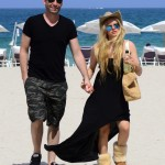 Exclusive... 51736774 Singer Avril Lavigne enjoys a romantic stroll on the beach with her husband Chad Kroeger on May 11, 2015 in Miami, Florida. Avril, who's recovering from Lyme Disease, looked a bit overdressed for the beach, wearing a black dress and Uggs as the couple walked hand-in-hand along the sand. **NO INTERNET USE** FameFlynet, Inc - Beverly Hills, CA, USA - +1 (818) 307-4813 RESTRICTIONS APPLY: NO WEBSITE USE