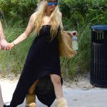 Exclusive... 51736785 Singer Avril Lavigne enjoys a romantic stroll on the beach with her husband Chad Kroeger on May 11, 2015 in Miami, Florida. Avril, who's recovering from Lyme Disease, looked a bit overdressed for the beach, wearing a black dress and Uggs as the couple walked hand-in-hand along the sand. **NO INTERNET USE** FameFlynet, Inc - Beverly Hills, CA, USA - +1 (818) 307-4813 RESTRICTIONS APPLY: NO WEBSITE USE
